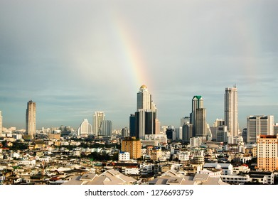 The rainbow with the skyscrapers in downtown, Bangkok cityscapes, the capital of Thailand in southeast Asia, in the morning of rainy season.