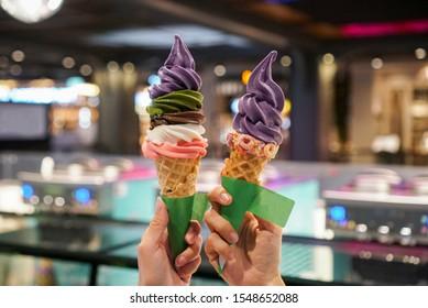 Rainbow soft serve ice cream tower. Two cone of rainbow ice cream with 5 flavour, strawberry, chocolate, milk, matcha green tea and purple sweet potato.