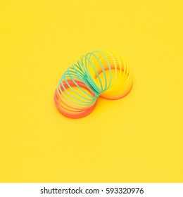 the rainbow spiral from childhood on yellow background.