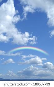 Rainbow, sun and blue sky