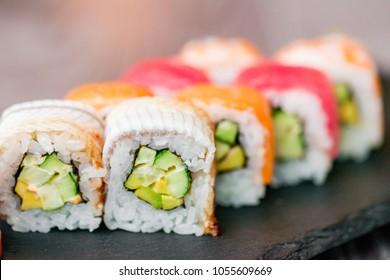 Rainbow sushi roll on tray close up