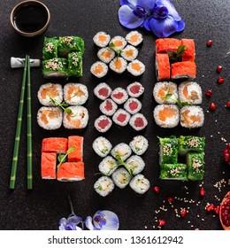 Rainbow Sushi Roll with salmon, eel, tuna, avocado, royal prawn, cream cheese Philadelphia