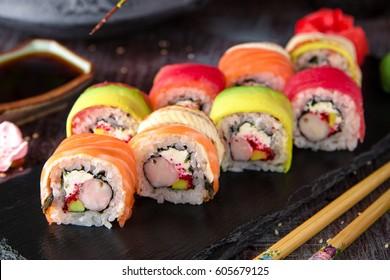 Rainbow Sushi Roll with salmon, eel, tuna, avocado, royal prawn, cream cheese Philadelphia, caviar tobica, chuka. Sushi menu. Japanese food.