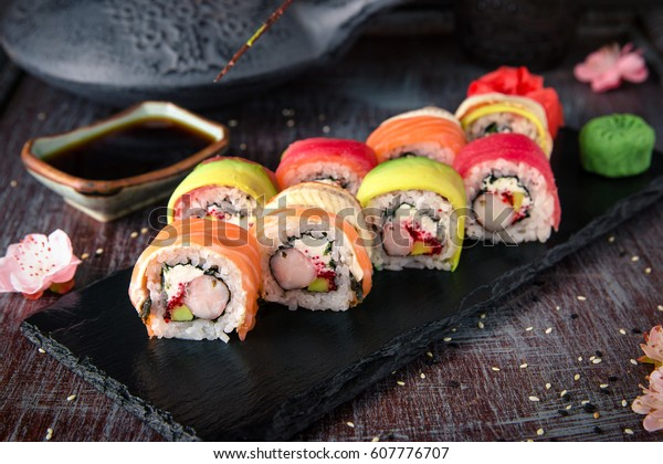 Rainbow Sushi Roll with salmon, eel, tuna, avocado, royal prawn, cream cheese Philadelphia, caviar tobica, chuka. Sushi menu. Japanese food.