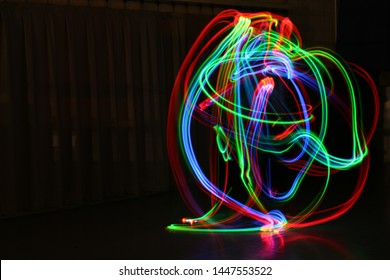 A Rainbow Tangle of Light on a black background