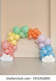 Rainbow theme balloons arch for birthday shoot indoor