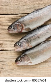 rainbow trout on a wooden board
