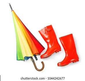 Rainbow umbrella with gumboots on white background