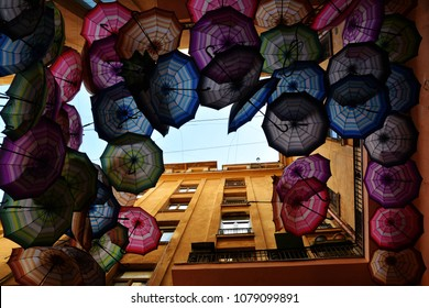 Rainbow umbrellas roof street in Victory Passage , Bucharest, Romania