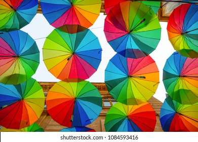 Rainbow umbrellas roof street in Victory Passage , Bucharest