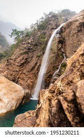 Rainbow waterfalls in Meghalaya India. Waterfalling over into a lagoon from a height.