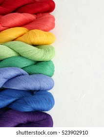 Rainbow yarn set on white background, bright rainbow yarn set, linen cotton thread skein