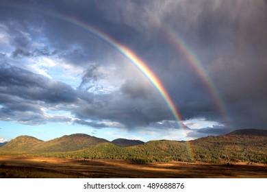 Rainbow in in Yazevoe valley, Altai mountains, Kazakhstan, Central Asia