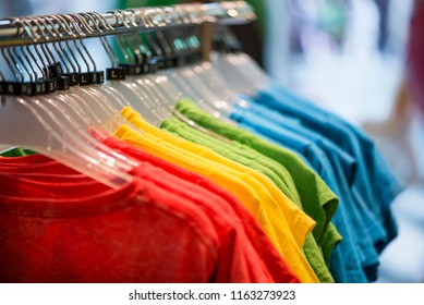 Rainbow-colors  t-shirts  hanging on rack