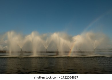 Rainbows are created during the operation of water barriers at thermal power plants. Cooling fountains beautifully lit
