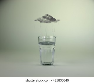 Raincloud over glass of water photo manipulation/Raining into glass of water