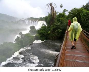 Raincoat man at waterfall