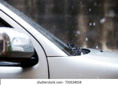 Raindrop falling on the windshield