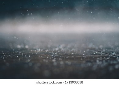 raindrop on the ground with background blur