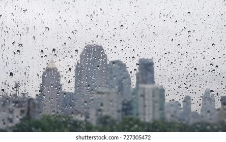raindrop on the window glass with building background