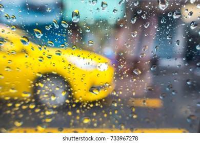 Raindrop on Windshield and car mirror on Traffic in rainy season