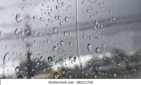 raindrops on car glass in a raining day.