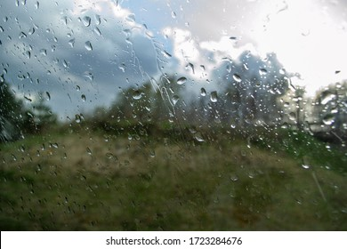 raindrops on car window in spring