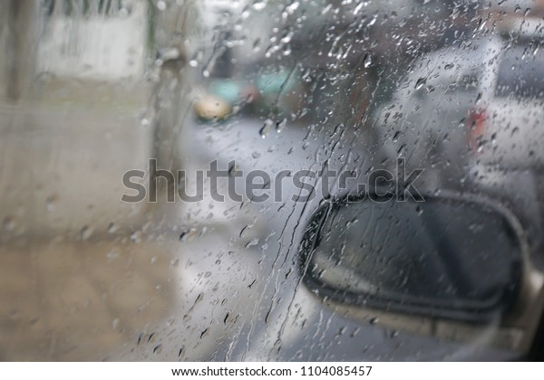 Raindrops on the car window. Transportation and weather concept.
