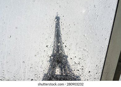 Raindrops on Eiffel Tower background.