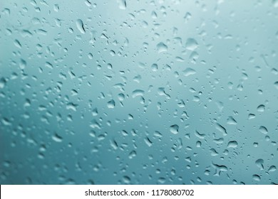 Raindrops on glass on a blue background