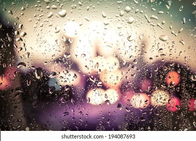 raindrops on glass. Outside the window the evening street