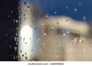 Raindrops on glass.  Water drops falling down on window. Rainy day. Wet glass