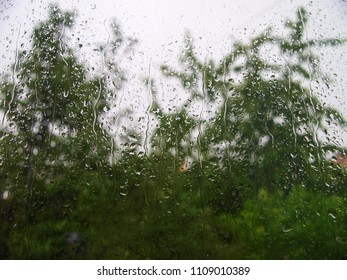 Raindrops on the glass of the window.
