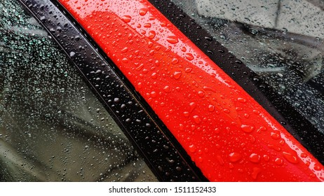 Raindrops on red car,  after rain concept.