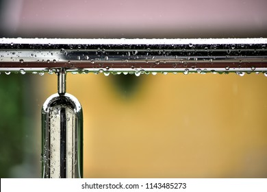 raindrops on stainless inox fence