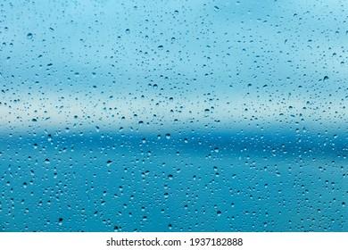 Raindrops on the transparent window pane. Background of raindrops.