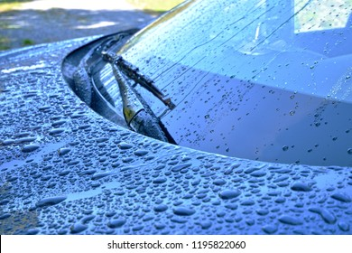 Raindrops on a Vehicle Windshield Abstract