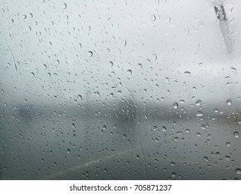 raindrops on window with blurry background