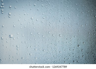 Raindrops on window in close up view , water condensation on glass