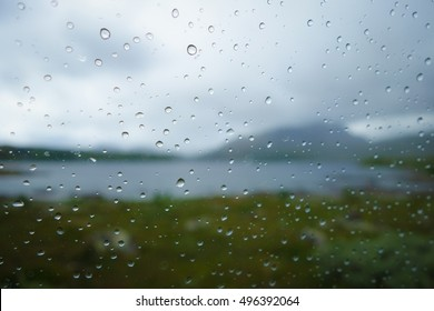 Raindrops on window, with distant mountain scenery