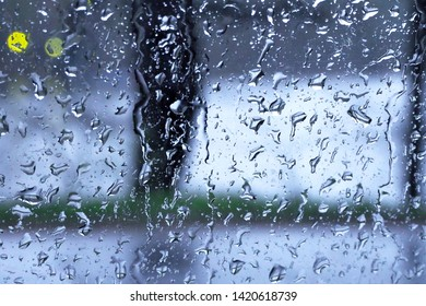 Raindrops on the window glass. Abstract background