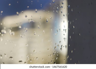 Raindrops on window glass at night. Horizontal photo. See thru.