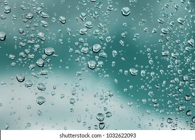 Raindrops on window glass , rainy day