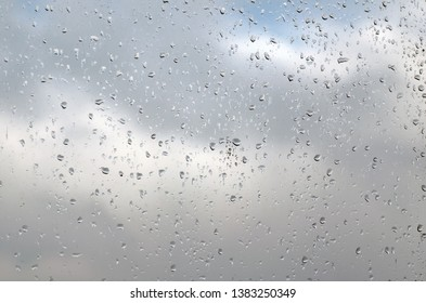 Raindrops on a window pane on a rainy day, texture background.