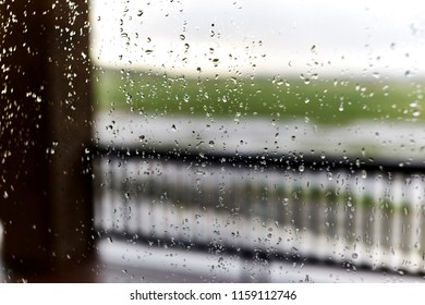 Raindrops on a window with shallow depth of field