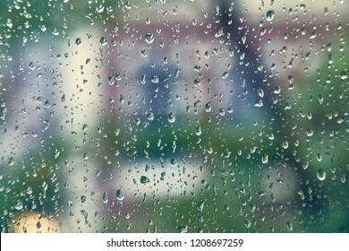 Raindrops on a window with urban street in the background