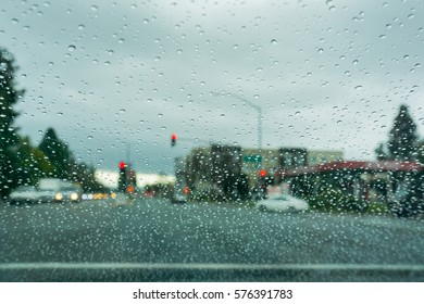 Raindrops on the windshield while driving on a rainy day, California