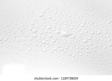 Raindrops water drop on window glass white background