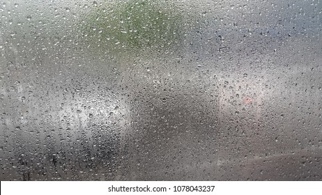 Raindrops in the Window's Glass on a Rainy Day