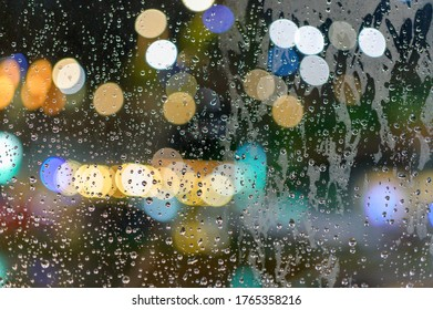 Rained down on the window. While there is light passing through the window as bokeh.